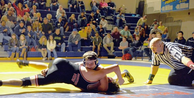 Steven Swafford works for near fall points Friday night during a home dual against Mountain View High School. Swafford won the match and the Eagles won the dual 33-24.