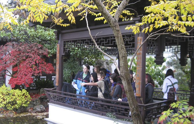 The Talented and Gifted program provides field trips and other enrichment activities for bright students. Above, middle school students learn the ancient story behind the Knowing the Fish pavillion in the Lan Su Chinese Garden in Portland. 	Contributed Photos/Lance Masters