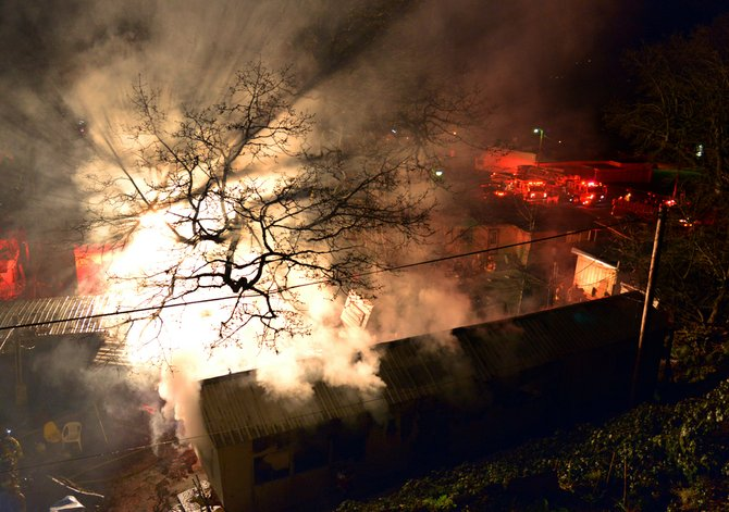 Fire crews battle a blaze in a single-wide mobile home on Cascade Street Thursday night.
