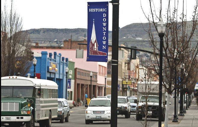 AFTERNOON TRAFFIC keeps Second Street bustling Jan. 31. The Dalles Main Street is fielding a revised proposal to tax downtown businesses to pay for its executive director and marketing strategy. 	Mark B. Gibson photo