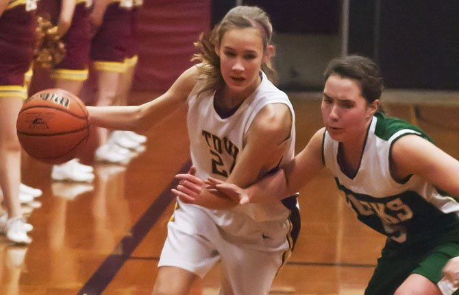 The Dalles Wahtonka sophomore Katie Conklin, left, slips around Pendleton freshman Ellie Richards during the first half of Friday's game in The Dalles. Mark B. Gibson photo