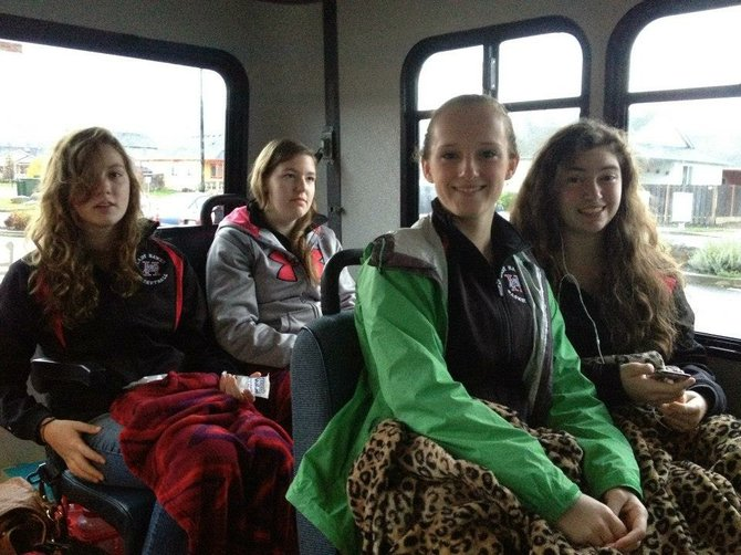 Happy and tired faces of (from left) Hannah Kempf,HannahLingel,  Alyssa Bryan and SarahRyan on the road.