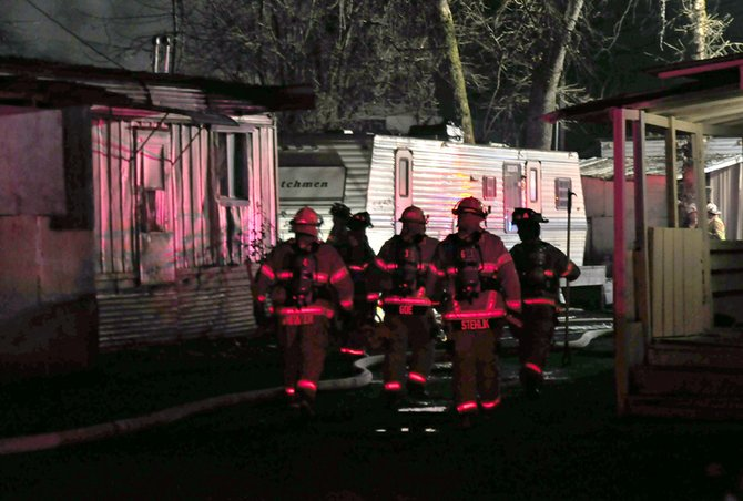 Firefighters head to the scene of a mobile home fire on Cascade St.