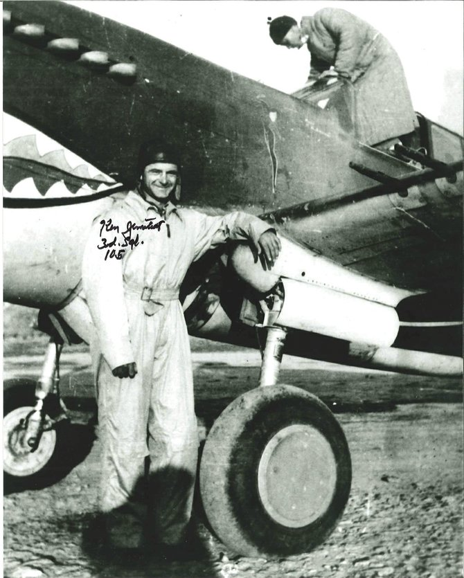 Flying Tiger Ken Jernstedt stands next to his plane during World War II. Piloting the iconic aircraft over Burma in 1941-42, he shot down more than 10 Japanese airplanes.