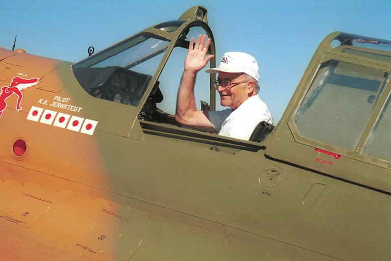Ken Jernstedt waves from his P40 Flying Tiger at the 1999 Fly-In in Hood River.