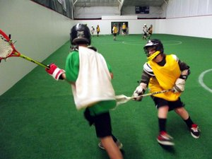 Arena style indoor youth lacrosse at The Dalles Fitness and Court Club's recently completed turf field.