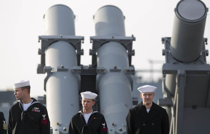 Sailors man the rails aboard the guided-missile destroyer USS Barry as the ship departs the Norfolk Naval Station  Feb. 7, 2013 for a 6-month deployment. The USS Barry has deployed to Europe to protect U.S. allies from ballistic missiles.  	