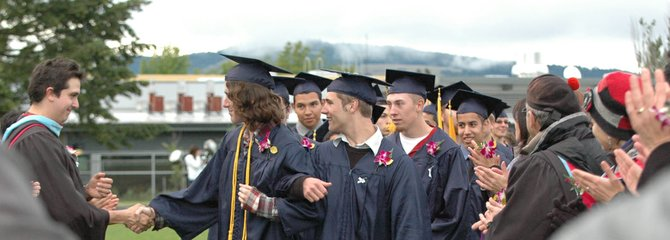 A handshake for good luck: Leadership advisor Niko Yasui congratulates Conor McDermott, a 2012 graduate at HRVHS.