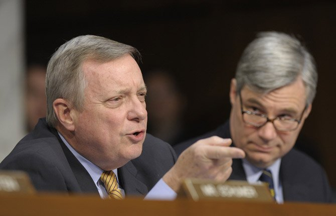 Sen. Richard Durbin, D-Ill., left, asks a question during a Senate Judiciary Committee hearing on gun violence,  Jan. 30.