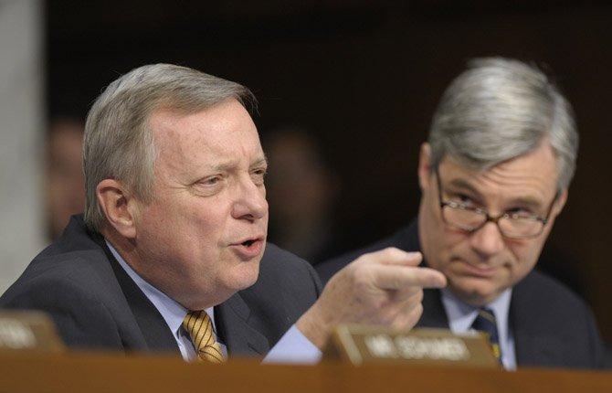 Sen. Richard Durbin, D-Ill., left, asks a question during a Senate Judiciary Committee hearing on gun violence,  Jan. 30.