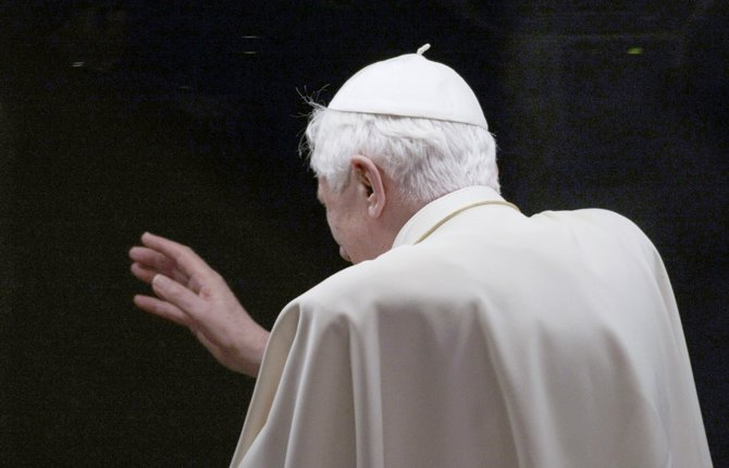 Pope Benedict XVI gestures from his popemobile in 2010 as he leaves a youth gathering, in St. Peter's square, at the Vatican.