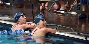 Kayla Schilling and Caitlyn Fick sharing a moment together after finishing first and second in the 50 freestyle qualifer.