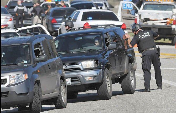 Redlands Police officers man a blockade after a shootout between fugitive Christopher Dorner and police.
