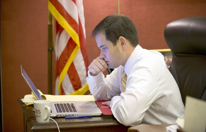 Sen. Marco Rubio, R-Fla., a rising star in the GOP who will deliver the Republican response to President Barack Obama's State of the Union address, works on his laptop fine-tuning his speech, in his Capitol Hill office in Washington, Thursday, Feb. 7, 2013.