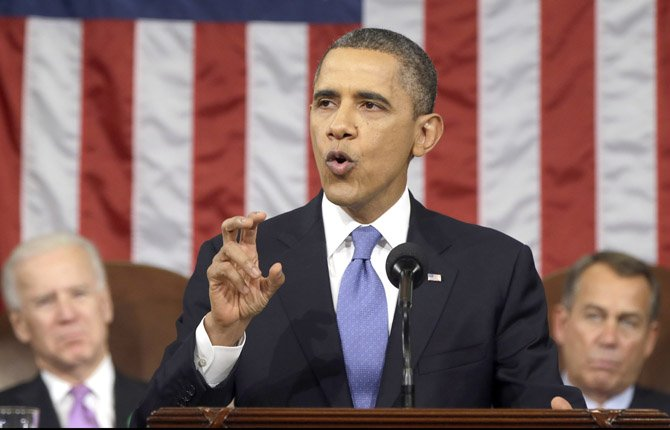 President Barack Obama, flanked by Vice President Joe Biden and House Speaker John Boehner of Ohio, gestures as he gives his State of the Union address during a joint session of Congress on Capitol Hill in Washington, Tuesday Feb. 12, 2013.