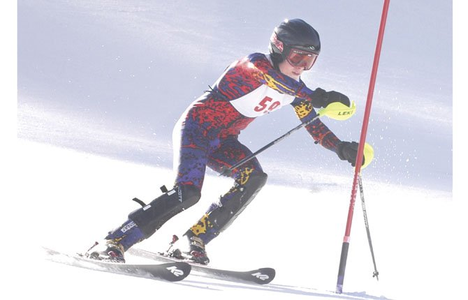THE DALLES WAHTONKA skier Eli Holeman glides down the hill in an event at Mount Hood Meadows. Holeman captured his third win of the season this past Saturday on Ski Bowl and grabbed the Mount Hood Ski League slalom championship after posting a time of one minute and 14.29 seconds.  	                                 