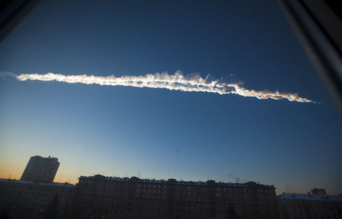 A meteorite contrail is seen over Chelyabinsk on Friday, Feb. 15, 2013. A meteor streaked across the sky of Russias Ural Mountains on Friday morning, causing sharp explosions and reportedly injuring around 100 people, including many hurt by broken glass. 	