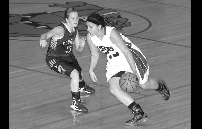 Dufur point guard Alexa Macias (right) dribbles past Echo's Hayden Tarvin in Friday's Big Sky District basketball game at Hermiston High School. The Lady Rangers advanced to the district championship with a 43-32 win.