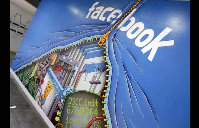 This Feb. 8, 2012 photo shows a mural at Facebook headquarters in Menlo Park, Calif. Intruders recently infiltrated the systems running the world's largest online social network but did not steal any sensitive information about Facebook's more than 1 billion users, according to a blog posting Friday, Feb. 15, 2013, by the company's security team.