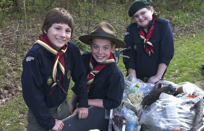 The Baden-Powell Service Association shows Pathfinder members Noah Kresse, Jude Atchley and Laura Gardner of the 10th Daniel Boone BPSA Scout Group working during an annual service project cleaning up 3 miles of trails along the Missouri River in Washington, Mo. The BPSA was founded in 2008 by David Atchley of Washington, Mo., who as a leader of his son's Cub Scout pack had a rift with regional BSA leaders over his efforts to adopt a nondiscrimination code.