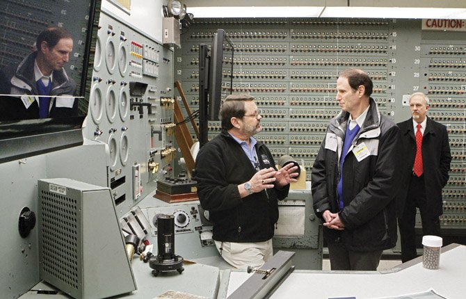 Sen. Ron Wyden, D-Ore., left, listens on Tuesday, Feb. 19, as Russ Fabre recounts the construction and operation of the first nuclear reactor, B Reactor, at the Hanford nuclear reservation near Richland, Wash. Wyden said he supports legislation to recognize the reactor as part of a national park to honor the top-secret Manhattan Project to build the atomic bomb.
