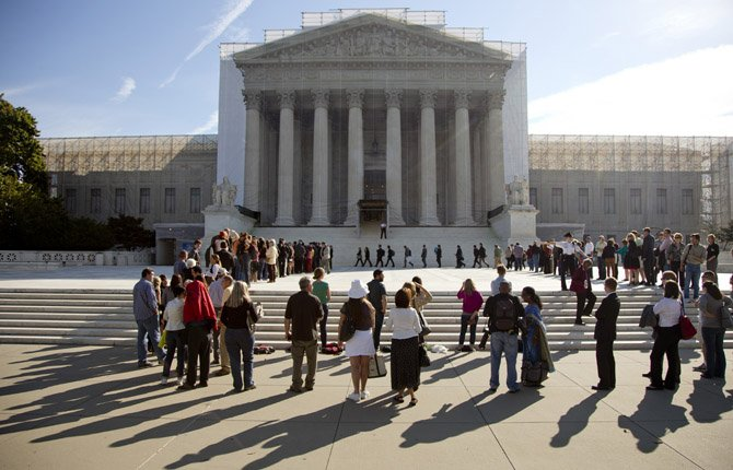 In this Oct. 1, 2012, file photo people wait in line to enter the Supreme Court in Washington at the start of the new term.