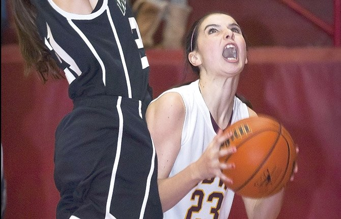 tdw'S Lori Cimmiyotti, right, goes for a shot but is fouled by Wilson's Rebecca Reese as the Tribe lead in the fourth quarter, 39-23. They won, 46-28.