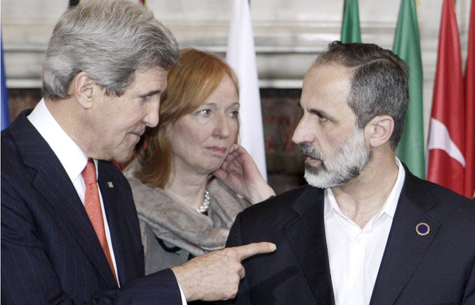 U.S. Secretary of State John Kerry, left, talks to Syrian opposition coalition leader Mouaz al-Khatib, during an international conference on Syria at Villa Madama, Rome, Feb. 28. The United States is looking for more tangible ways to support Syria's rebels and bolster a fledgling political movement that is struggling to deliver basic services after nearly two years of civil war, Kerry said Wednesday.