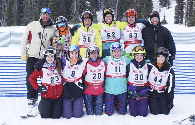 THE DALLES WAHTONKA ski team members and coaches stand in for a group shot after skiing at a recent event at Mount Hood Meadows. They are (pictured from left to right, front row), Alyssa Carrico, Maya Barnard-Davidson, Carsen Cordell, Bailey Cordell, Emma Ell-Smith and Zoe Ley. In the back row are, head coach Jeff Cordell, Mark Johnson, Eli Holeman, Kale Underhill, Travis Diede and assistant coach Steve Dugick. This past Saturday, both the boys and girls qualified for the state event on Skibowl.