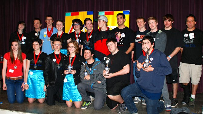 Three Hood River Valley High School robotics teams advance to state finals in the First Tech Challenge competition this weekend.  Top, right to left: Josh True, Barry Paul (coach), Conner Dunn, Sophia Oswald, Eric Hamada, Marten Sova, Taylor Cramer, Mathew Harris, Conner Webb, Wells Bishop, Brodie Sutherland and Jeff Blackman (coach); bottom, right to left: Tabitha Merten, Roslyn Patric-Sunnes, Maxx Kozec, Lilly Paul, Nick Cooper and Austin Dalbey.