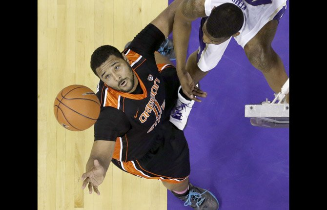 Oregon State's Joe Burton, left, reaches for a rebound in front of Washington's Shawn Kemp, Jr. in the first half of an NCAA college basketball game Feb. 16 in Seattle.