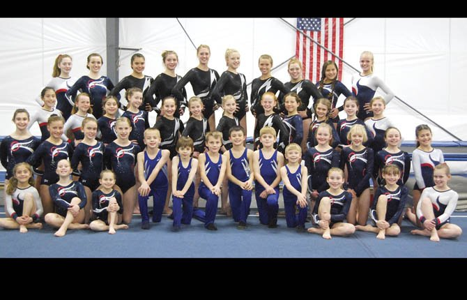 Riverside Gymnastics Academy competing girls and boys team members pose for a team picture during practice at the Riverside facility in The Dalles. The members reprsetned are the Girls Level 4, 5, 6, 7 and 8 along with the Boys Level 4. Both teams were in action last month and the girls level 5 group grabbed first place in beam and the level 4 boys secured third place.