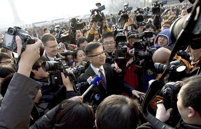 U.S. Ambassador to China Gary Locke, center, is mobbed by journalists as he attends the opening session of the annual National People's Congress at the Great Hall of the People in Beijing March 5. The United States and China have reached an agreement on a new draft sanctions resolution to punish North Korea for its latest nuclear test, U.N. diplomats said late Monday. 	AP