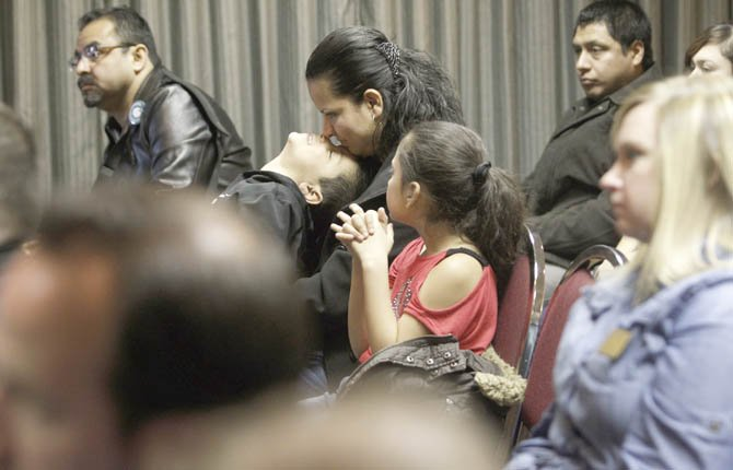 Marisol Guerrero, with her son, Bryan Chavez, 4, and daughter Ashley Chavez, 7, listens to speakers March 5 in Yakima at a news conference to announce the Washington Compact, a document that outlines five principles that supporters hope will guide Congress as it works on immigration reform.
