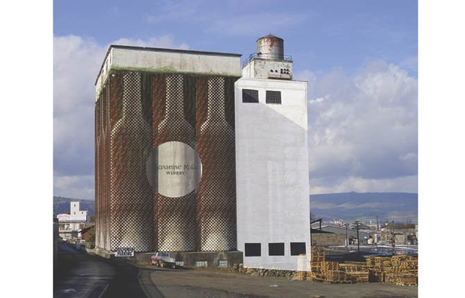 SUNSHINE MILL is proposing to develop the silos at its historic site as a hotel, which would require exterior insulation the business owners hope to conceal with screens that look like wine bottles. Below, the Quaker Square Hilton in Akron, Ohio, offers a precedent for converting silos to hotel rooms.	
