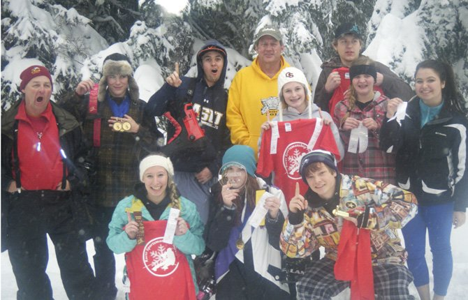 THE DALLES WAHTONKA ski team shows off awards and trophies for top skiing efforts this season. Last weekend at the Mt. Hood Ski League Awards banquet many TDW skiers were honored.