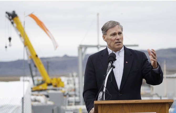 Washington Gov. Jay Inslee talks to reporters March 6 as he tours the Hanford Nuclear Reservation near Richland, Wash. Inslee was at Hanford to meet with Dept. of Energy officials in order to learn more about tanks on the site that are leaking radioactive waste. 	