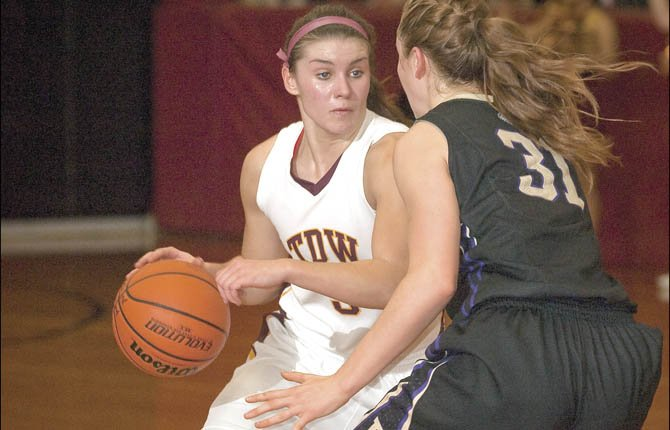 THE DALLES WAHTONKA junior Emily Bailey (left) looks for an open teammate while being guarded by Hermiston's Shelby Sanders during 5A girl's hoops action this season. Bailey was named as the Columbia River Conference's Player of the Year and etched her name of the first-team list after a solid 2012-2013 campaign.