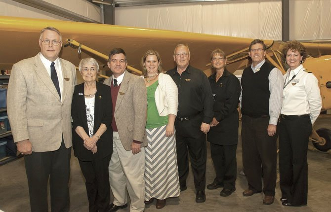 AN AIRPLANE HANGAR at the Columbia Gorge Municipal Airport in Dallesport provided an aviation theme for the annual Tradition of Compassion Philanthropy Awards ceremony Thursday, March 7. Honorees pictured above include, from left to right:, Community Service Organization award winners Paul Viemeister, representing The Dalles Wahtonka Key Club and co-winners Sherry Munro and John Westhafer, representing the Kiwanis Builders club at The Dalles Middle School; Outstanding Philanthropic Corporation winners Cousins' Restaurant and Lounge were represented by Addie Case, Tom Krueger, and Dean Ferrell; and Outstanding Philanthropist award winner Bob Schultens. Representing the Mid-Columbia Health Foundation, which presents the Tradition of Compassion Philanthropy Awards, is Celeste Hill Thomas, foundation executive director.