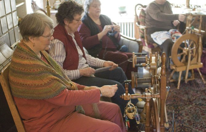 SPINNERS SHARE space at Fran Connolly's house for weekly Tuesday morning spinning sessions of the Columbia Fibres Guild. Pictured from left are Marian Dyche, Deb Hucke, Linda Bollmer and Linda Horton (in background).