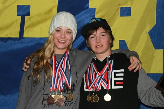 State champs Kayla Van Hoose and Tucker FitzSimons pose with hardware from the March 7-8 OISRA State freestyle skiing championships. The two won overall and individual titles in every event.