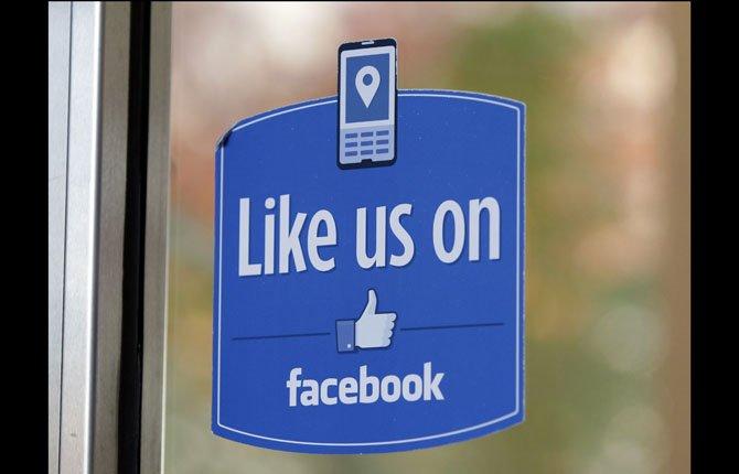 "FILE - In this Dec. 13, 2011 file photo, a sign with Facebook's ""Like"" logo is posted at Facebook headquarters near the office for the company's User Operations Safety Team in Menlo Park, Calif. A study by researchers at Cambridge, published Monday, March 11, 2013 in the Proceedings of National Academy of Sciences, has found that clicking the social network's friendly blue ""like"" buttons may reveal more about people than they realize."