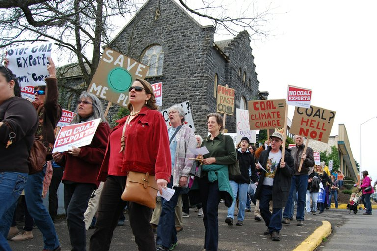 Anti -coal protestors walk past Riverside Church on State Street.