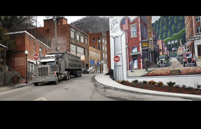 a coal truck drives out of downtown Welch, W.Va. in this Feb. 9, 2011 file photo. A record number of U.S. counties are now dying off.