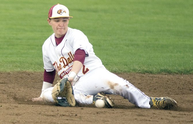 THE DALLES WAHTONKA baseball player Steven Bartells slides in the hole for a groundball in 5A action last season. The Tribe have a potent roster of nine returners back for a squad that ranked 12th offensively with 169 runs scored. File photo