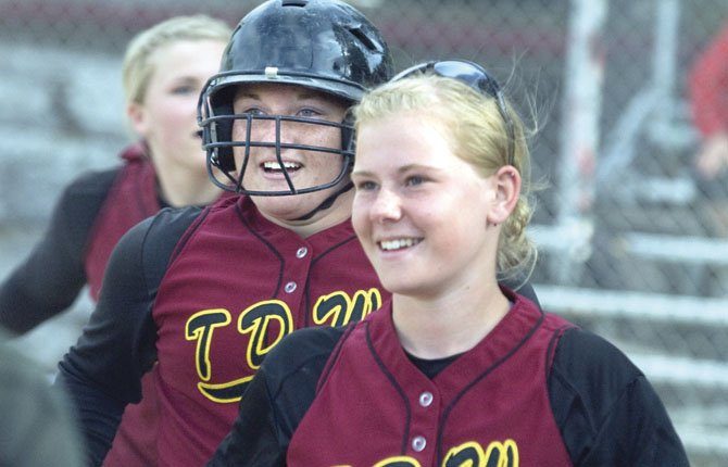 TDW teammates Kella DeHart (front), Melanie Taphouse and Katherine Kramer are all smiles after a big hit during softball play in 2012. The Eagle Indians are looking to extend their semifinals streak to six years in a row. File photo