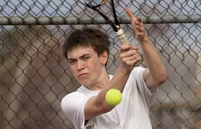 The Dalles WahtonkA's first singles competitor Griffin Martin slams a shot at his Reynolds opponent during Thursday's matchup in The Dalles. TDW worked an 8-0 victory in its second match of the year.