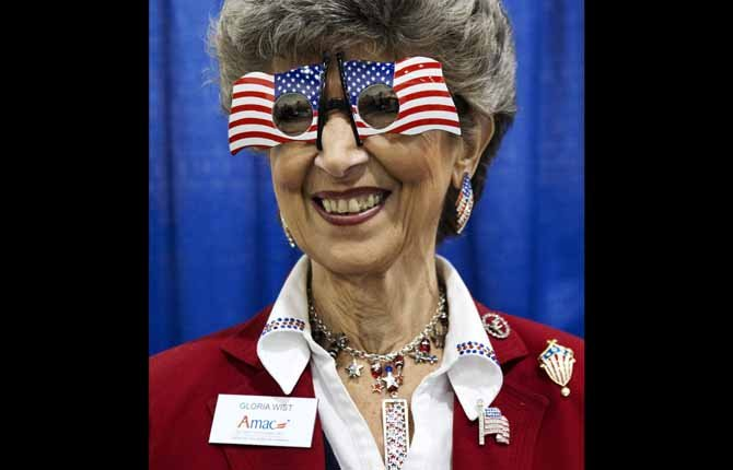 Gloria Wist of Lady Lake, Fla., with the Association of Mature Americans, poses for a portrait while attending the 40th annual Conservative Political Action Conference in National Harbor, Md., March 15. 	