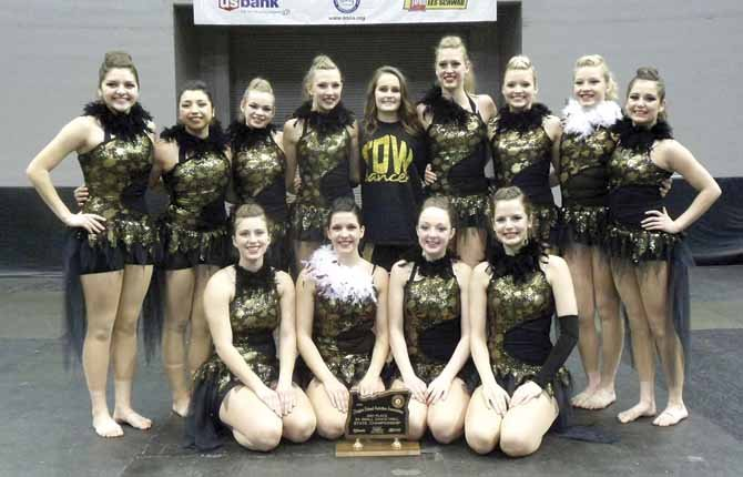 MEMBERS OF The Dalles Wahtonka's dance/drill team gather around for a group photograph after taking third place honors at the OSAA Dance/Drill State Tournament Thursday at Veterans Memorial Coliseum in Portland. The participants are (pictured from left to right, starting the back row), Alejandra Pena, Alyssa Valles, Sydney Shade, Riley Nelson, Carmen Hrigora, Hannah Hinshaw, Ashley Munsen, Taylor Sugg and Lilly Ley. In the front row are (pictured from left to right), seniors Drew Hamm, Aubrey Hansen, Emily Chance and Amanda Cimmiyotti. This is the first time TDW has won a state trophy in the three years since moving from strictly cheerleading competitions, where they won 12 titles, to dance and drill. Hansen ended the week with a nod on the all-state team.