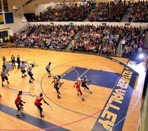 Derby Debut — The Gorge Roller Girls hosted its first official home bout Saturday night in front of a sell-out crowd of about 900 at Hood River Valley High School. The bout was between GRG teams River Reapers (in black) and Cherry Bombers (in red). 